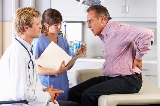 С болью в пояснице у врача